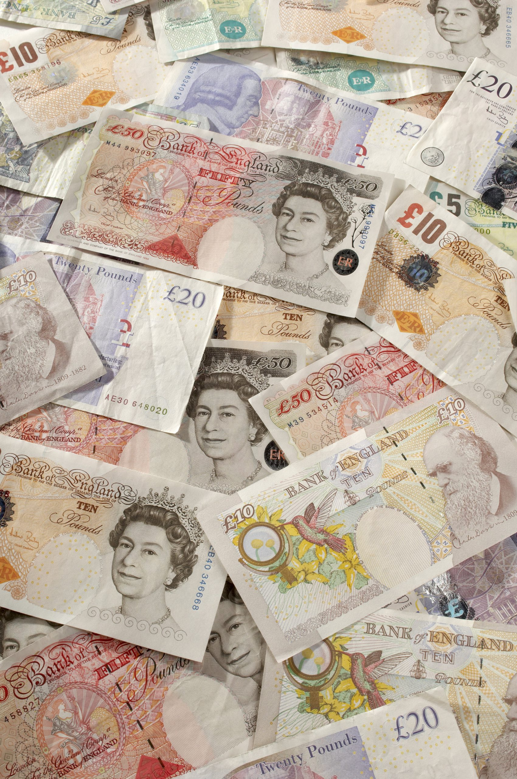 British paper currency mixed notes pile
