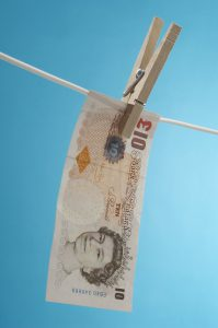 British paper currency on clothesline