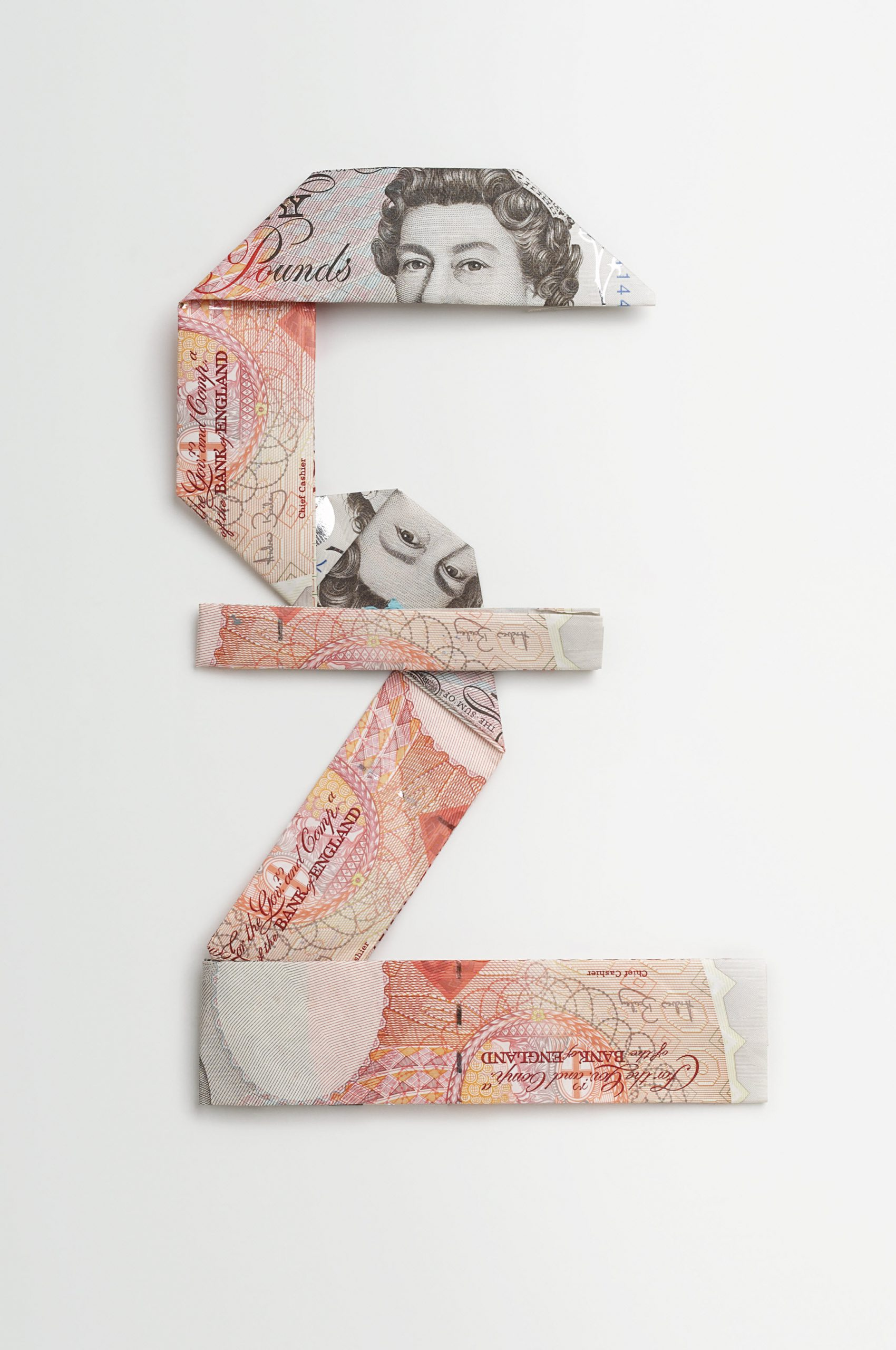 Pound sterling symbol made of folded banknotes